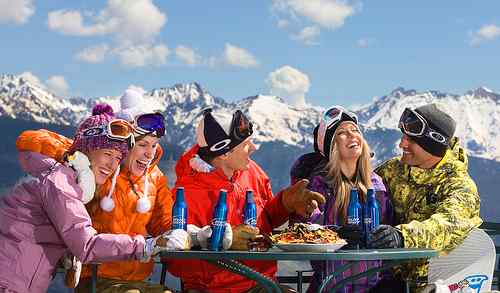 Enjoying food and drink on and off the Piste with friends on a ski holiday