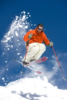 skier racing down the snow