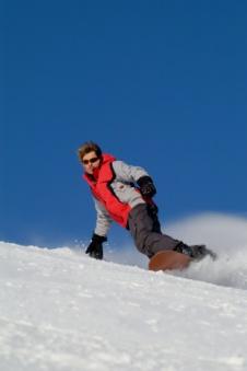 Snowboarder speeding downhill