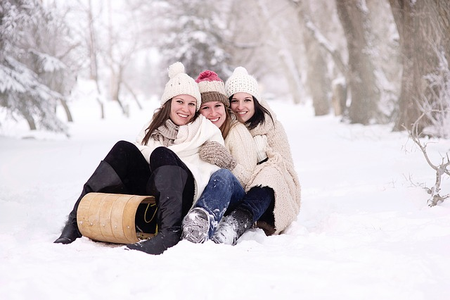 Three girls on a wooden sledge