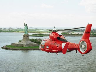 Helicopter flight experience day flying over the Statue of Liberty New York City
