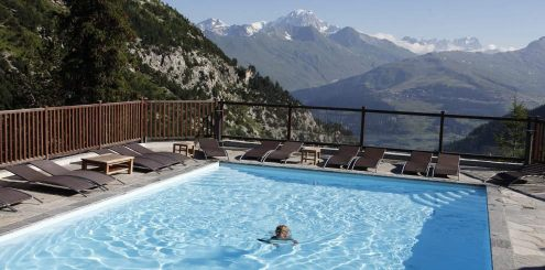 Relaxing in pool in French Alps