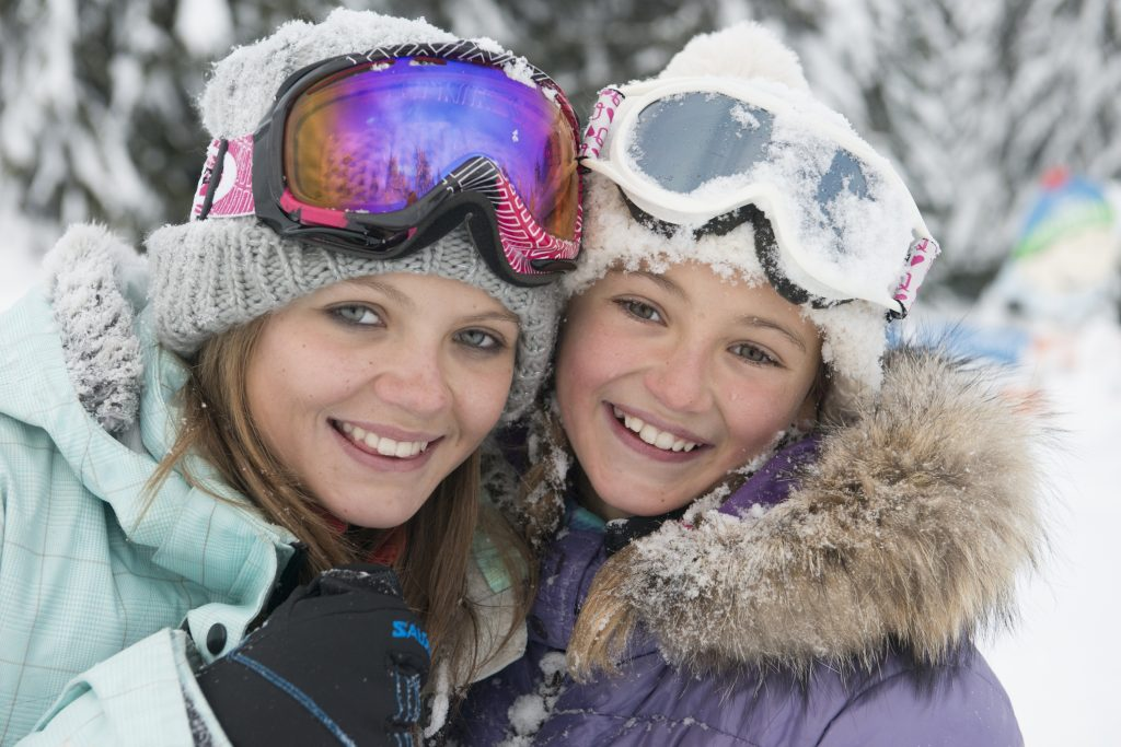 Girls together skiing