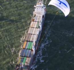 Container ship being towed by a massive power kite