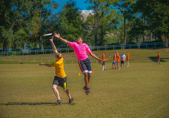 Ultimate frisbee game jumping to catch disc