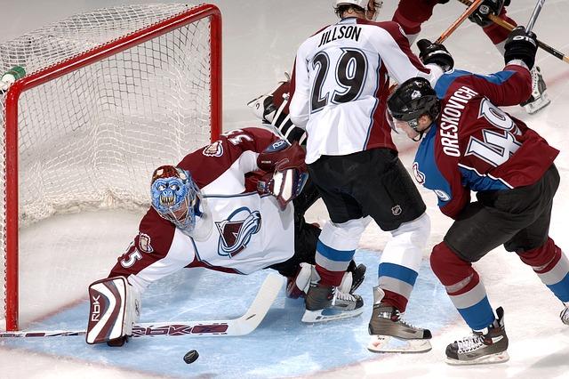 Ice hockey players scoring a goal