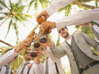 Guys enjoying a beer on a stag do