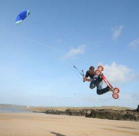 Kiteboarding with a power kite