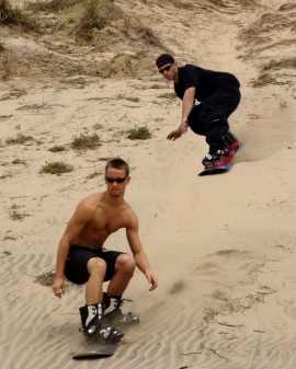 Cool dudes sandboarding