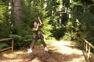 Young Girl on a Go Ape Zip Wire