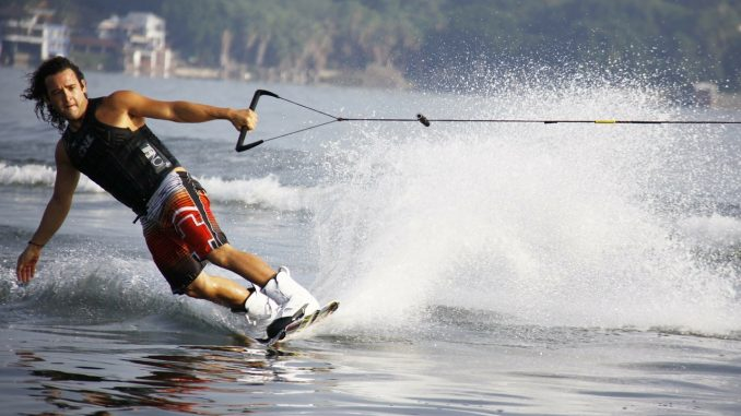 Mam wakeboarding on a lake