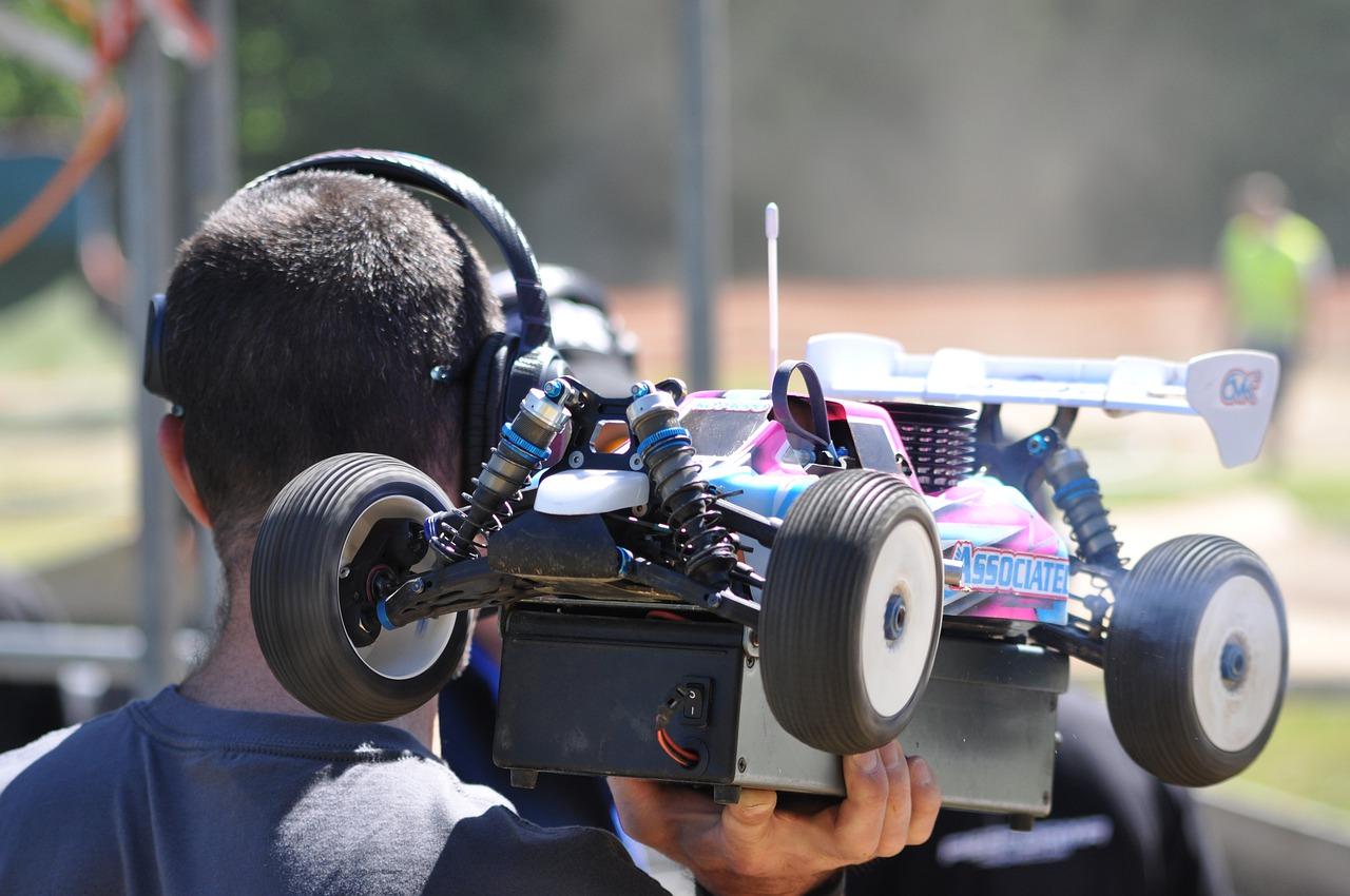 man holding his rc car ready for racing