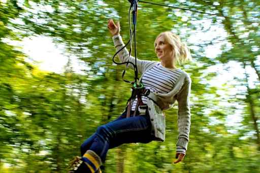 Girl on zip wire at Go Ape