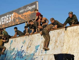 Climbing a wall on the Tough Mudder obstacle course race