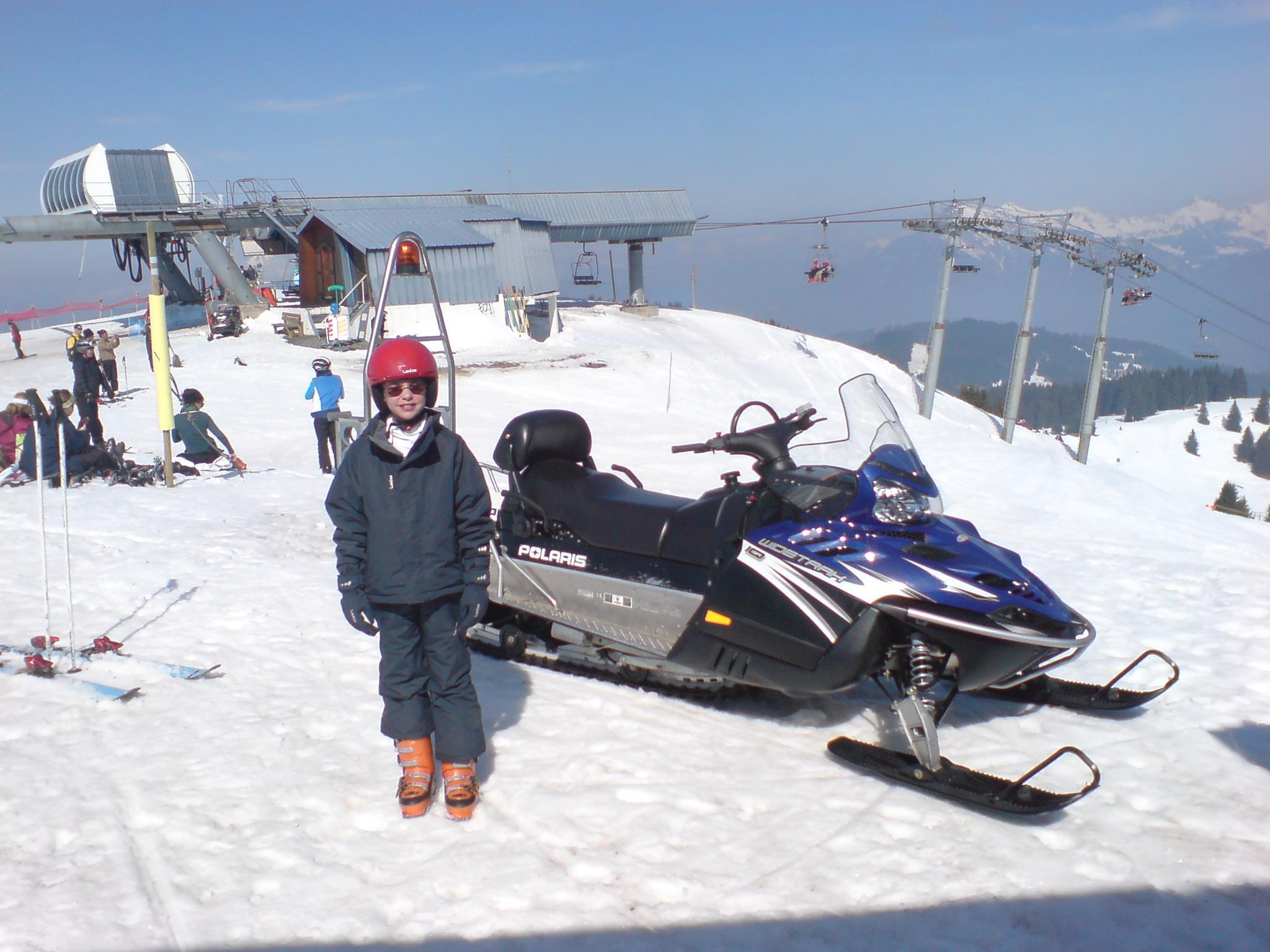 Snowmobile on snowy mountain