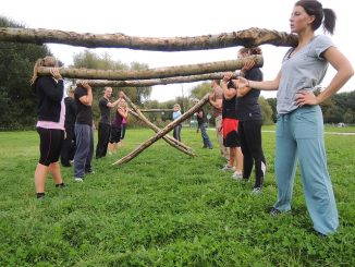 Women at a fitness bootcamp providing group training