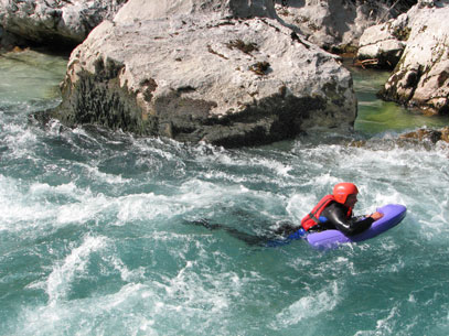 Hydrospeeding down river rapids in the French Alps