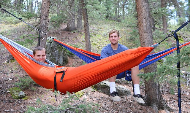 Two men in camping hammocks