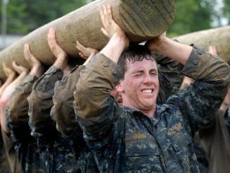 military team building carrying telegraph pole