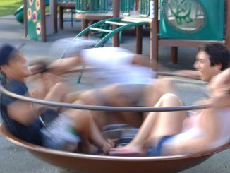 teens enjoy this playground equipment for social spinning