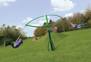 Rotating playground swing for teens