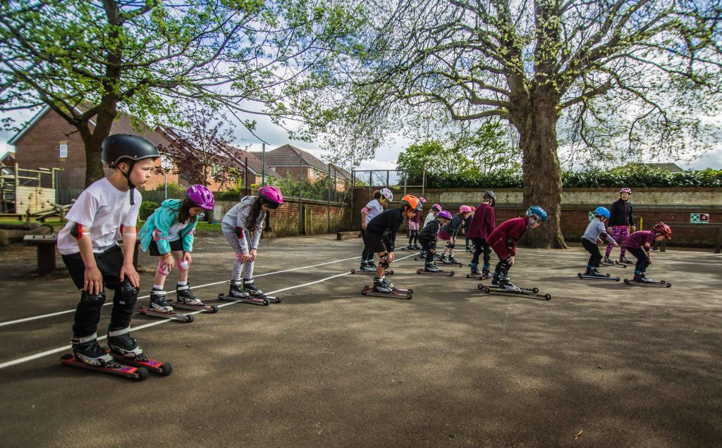 Teens learning to rollerski