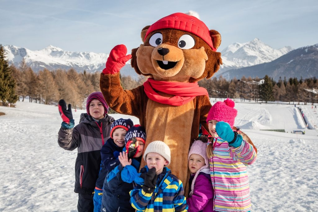 Mascot Bibi on Snow Island in Crans Montana with kids