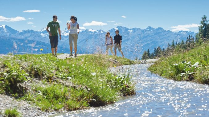 Couples enjoying summer activities in Crans Montana Switzerland