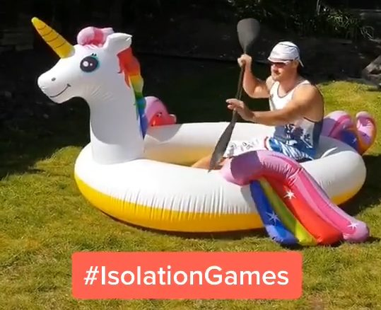 Isolation games kayaking in an inflatable unicorn