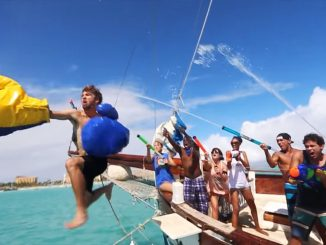 Man jumping ship in a water fight
