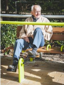 Senior citizen doing cardio exercises at a senior fitness park