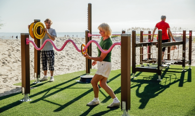 Senior citizens exercising at an outdoor fitness park