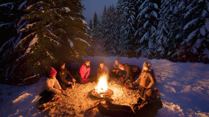 Outdoor Comfort round a campfire in winter snow