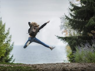 Woman jumping for joy outdoors, full of health and resilience